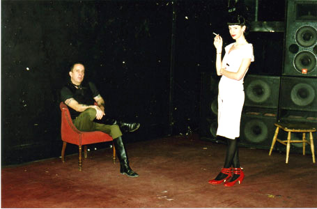 Weatherall on a chair... with a lady.